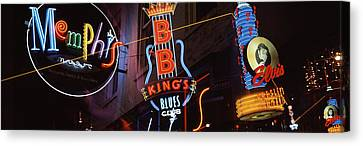 Low Angle View Of Neon Signs Lit Canvas Print by Panoramic Images