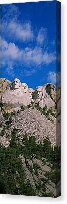 Low Angle View Of Sculptures Of Us Canvas Print by Panoramic Images