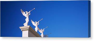 Low Angle View Of Statues On A Wall Canvas Print