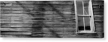 Low Angle View Of The Window Of A Log Canvas Print