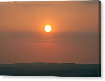 Low Setting Sun Over Distant Landscape Canvas Print by Matthew Gibson