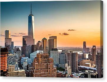 Canvas Print featuring the photograph Lower Manhattan At Sunset by Mihai Andritoiu