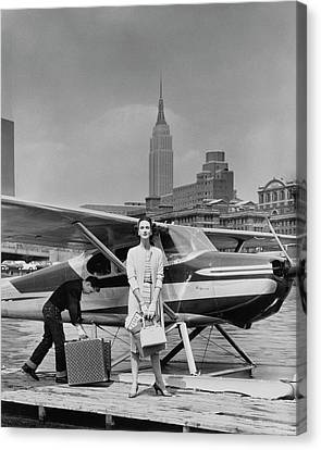 Lucille Cahart With Small Plane In Nyc Canvas Print by John Rawlings