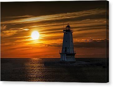 Ludington Pier Lighthead At Sunset Canvas Print by Randall Nyhof