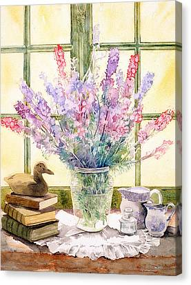Lupins On Windowsill Canvas Print by Julia Rowntree