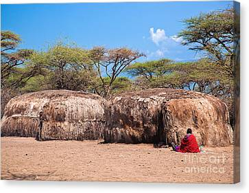 Maasai Huts In Their Village In Tanzania Canvas Print by Michal Bednarek