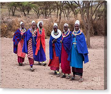 Maasai Women In Front Of Their Village In Tanzania Canvas Print by Michal Bednarek