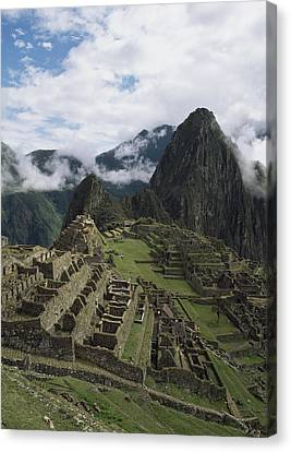 Machu Picchu Canvas Print by Chris Caldicott