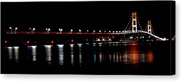 Canvas Print featuring the photograph Mackinac Bridge At Night by Michael Donahue