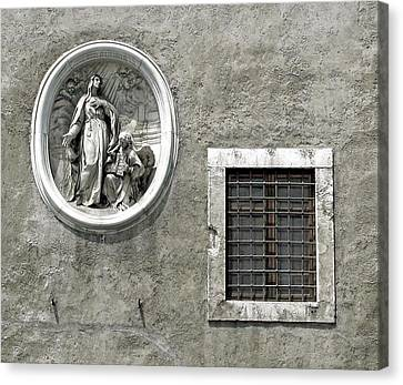 Madonna Of The Wall Canvas Print by Jean Hall