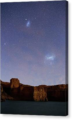 Magellanic Clouds Over Cliffs Canvas Print by Luis Argerich