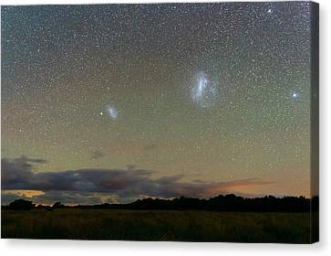 Magellanic Clouds Over The Pampas Canvas Print by Luis Argerich