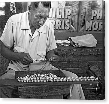 Making Puka Shell Necklaces Canvas Print by Underwood Archives