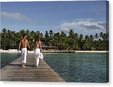 Openair Canvas Print - Maldives, Couple Walking On Pier � by Tips Images