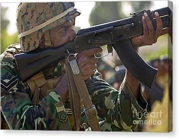 Ak-47 Canvas Print - Maldivian Marine Fires An Ak-47 Service by Stocktrek Images