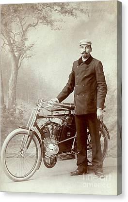 Man And His Ride Canvas Print by Jon Neidert