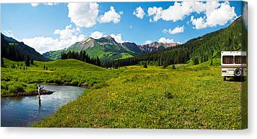 Man Camping Along Slate River, Crested Canvas Print by Panoramic Images