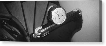 Man Carrying Clock Up Stairs On Canvas Print by Panoramic Images