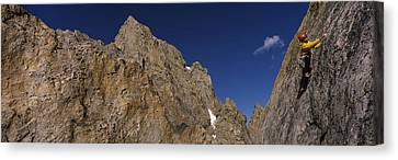 Man Climbing Up A Mountain, Grand Canvas Print by Panoramic Images