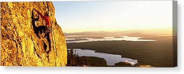 Man Climbing Up A Mountain, Rockchuck Canvas Print by Panoramic Images