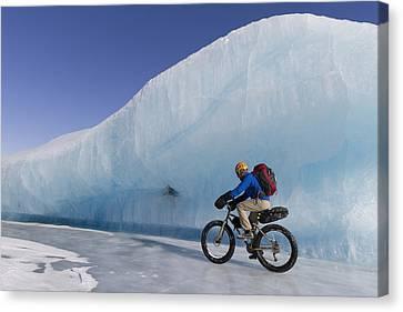 Man Fat Tire Mountain Biking On Ice At Canvas Print by Joe Stock
