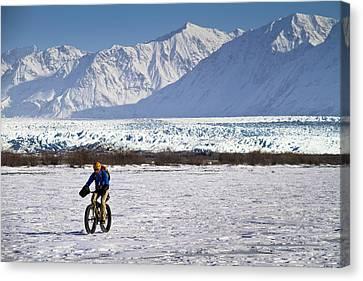Man Fat Tire Mountain Biking On The Canvas Print by Joe Stock