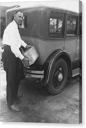 Man Filling Car With Fuel Canvas Print by Underwood Archives