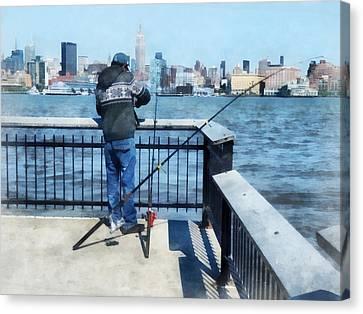 Man Fishing Off Hoboken Pier Canvas Print by Susan Savad