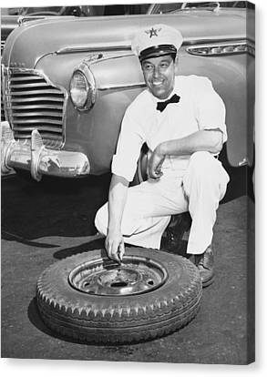 Confidence Men Canvas Print - Man Fixing A Flat Tire by Underwood Archives