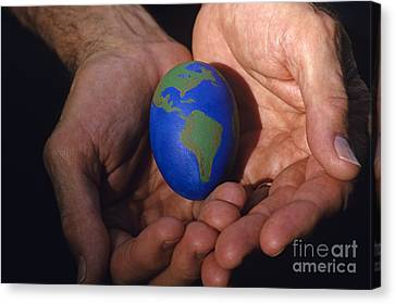Man Holding Earth Egg Canvas Print by Jim Corwin