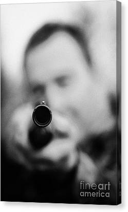 Man In Camouflage Clothes Takes Aim At Camera With Shotgun Close Up  On December Shooting Day Canvas Print