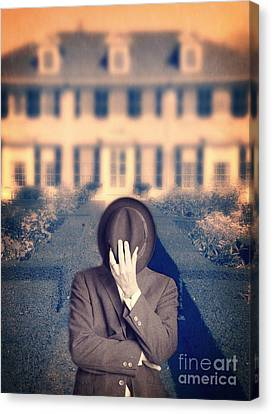 Man In Front Of Mansion  Canvas Print by Edward Fielding
