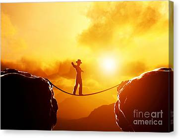 Man In Hat Walking On Rope Over Mountains Canvas Print by Michal Bednarek