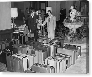 Man In Lobby With Suitcases Canvas Print by Underwood Archives