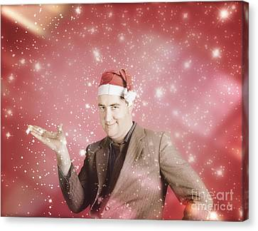 Man In Santa Hat Displaying Christmas Copyspace Canvas Print by Jorgo Photography - Wall Art Gallery