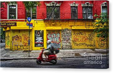 Man On A Moped Passing By The Red And Yellow Buiding Canvas Print