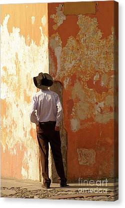Canvas Print featuring the photograph Man On The Corner Antigua Guatemala by John  Mitchell
