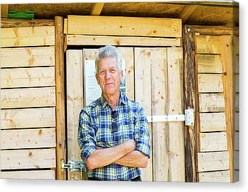 Man Outside Garden Shed Canvas Print by Gombert, Sigrid