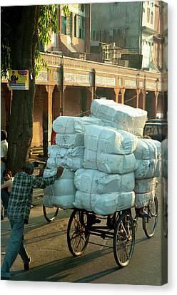 Man Pushing An Overloaded Cart, Jaipur Canvas Print by Inger Hogstrom