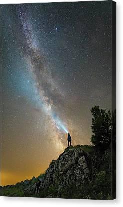 Man Shining A Flashlight On The Milky Canvas Print by Yuri Zvezdny