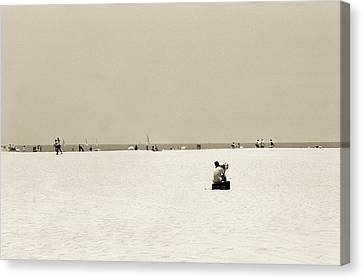 Man Sitting On A Beach Playing His Horn Canvas Print by Stephen Spiller