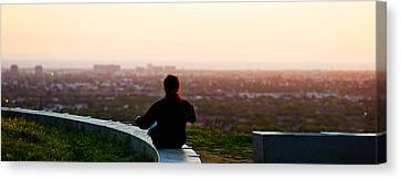Man Sting On The Ledge In Baldwin Hills Canvas Print by Panoramic Images