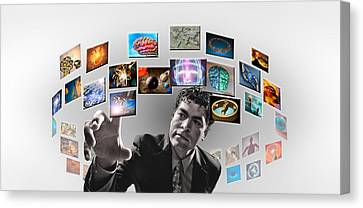Man Surrounded By Imagery Canvas Print by Panoramic Images