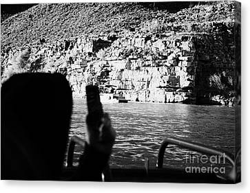 man taking photos with smartphone during boat ride along the colorado river in the grand canyon Ariz Canvas Print by Joe Fox