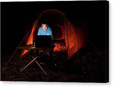 Man Using Laptop Outside A Tent Canvas Print by Matthew Oldfield