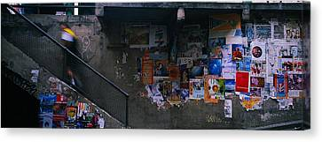 Man Walking Upstairs From Post Alley Canvas Print by Panoramic Images