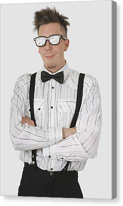 Man Wearing Sunglasses Suspenders And Canvas Print by Stock Foundry