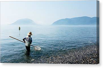 Man With A Net Canvas Print