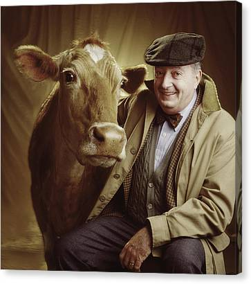 Man With Cow Canvas Print
