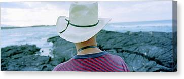 Man With Straw Hat Galapagos Islands Canvas Print by Panoramic Images